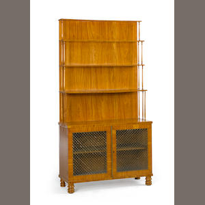 A Regency satinwood bookcase cabinet. early 19th century