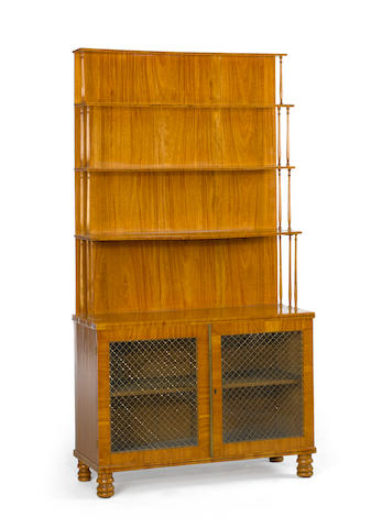 A Regency satinwood bookcase cabinet<BR />early 19th century