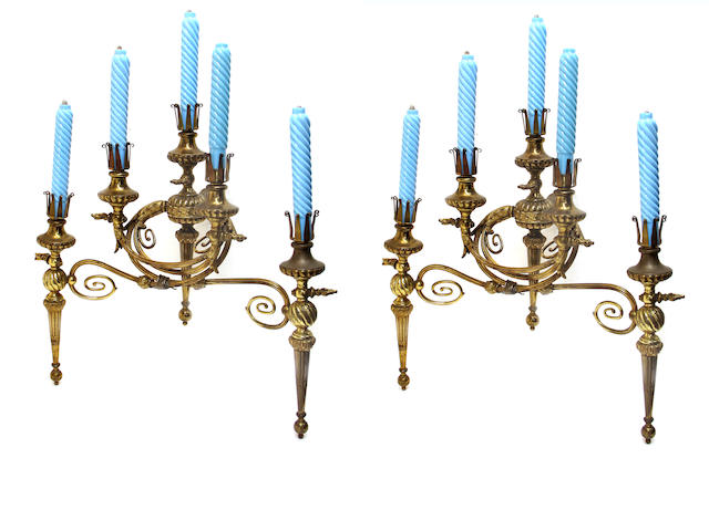 A pair of American Victorian gilt brass five arm gas wall lights with blue glass faux candlestick covers fourth quarter 19th century