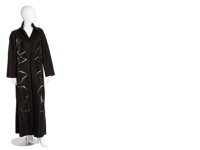 A Ferretti black wool coat with cut outs decorated with black beading