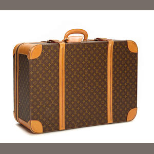 A group of two Louis Vuitton medium luggage cases