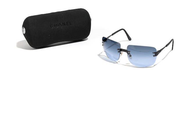 A pair of Chanel black sunglasses