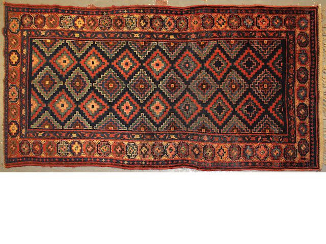 A Kurdish long carpet  size approximately 4ft. 4in. x 9ft. 7in.