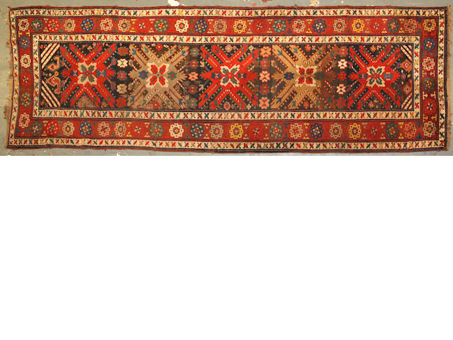 A Turkish runner size approximately 3ft. 4in. x 10ft. 5in.