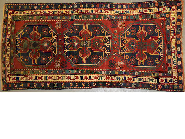 A Kazak long carpet size approximately 5ft. 1in. x 10ft. 7in.