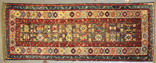 A Caucasian rug size approximately 3ft. 5in. x 9ft. 7in.