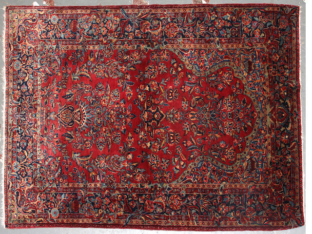 A Sarouk rug size approximately 4ft. x 6ft. size approximately 4ft. x 6ft.