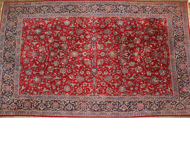 A Kashan carpet  size approximately 8ft. 14in. x 13ft. 4in.