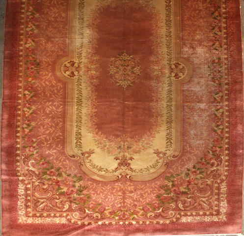 An Austrian Savonnerie style carpet  size approximately 8ft. 4in. x 15ft.