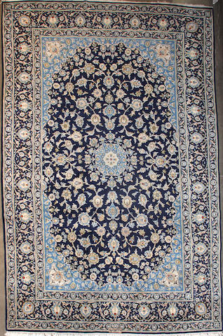 A Kashan carpet  size approximately 7ft. 2in. x 10ft. 6in.