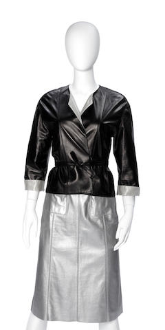 A Chanel silver and black leather short wrap and tie jacket