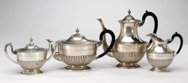 A Portuguese 833 standard silver four piece tea and coffee set with wooden fittings W. A. Sarmento (Ourivesaria Sarmento), Lisbon  (4)
