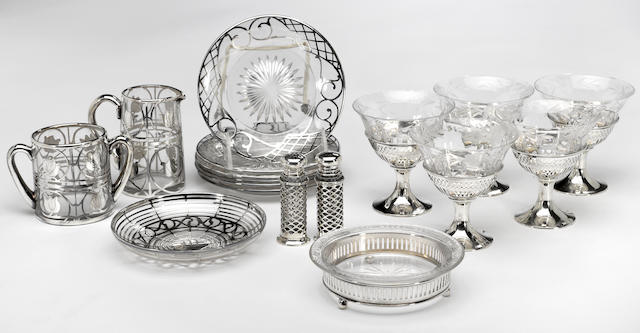 A group of sterling and silver deposit on clear glass table articles