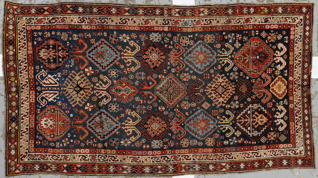 A Caucasian rug Caucasus size approximately 5ft. 7in. x 9ft. 10in.