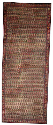 A Senneh long carpet  Central Persia size approximately 7ft. 1in. x 18ft. 4in.