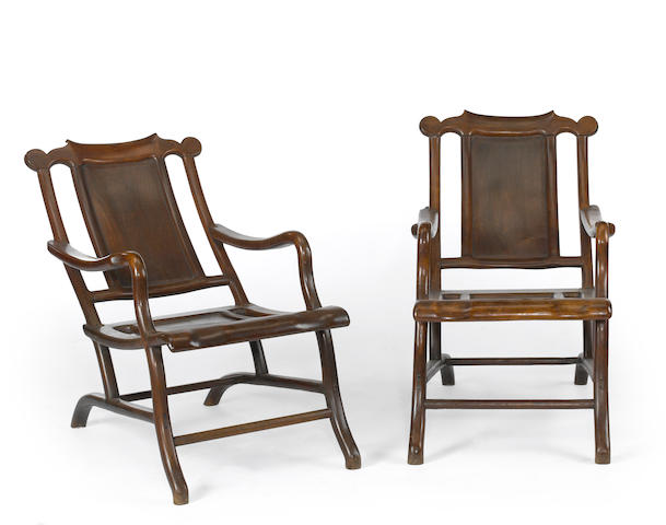 A pair of Chinese hardwood reclining chairs<BR />19th century * From the Collection of Doris Suke. Provenance Robert Ansteth Ltd. Honolulu Hawaii 10 July 1951 *