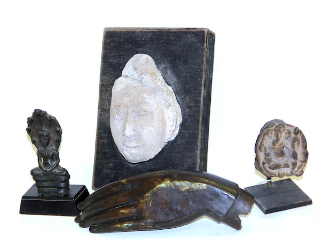 A group of four Buddhist sculptural fragments