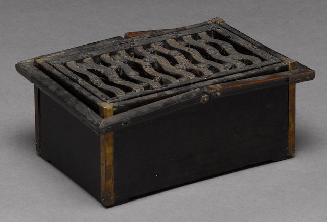 A stained wood portable hand warmer 19th century