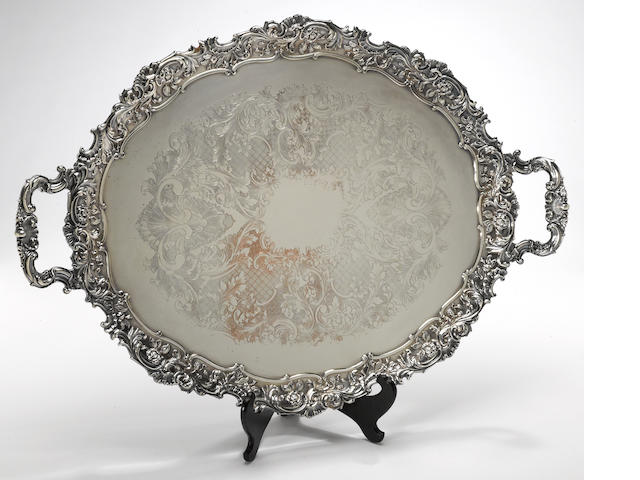 "A group of three graduated large plated tea trays I Freeman & Son, England, ""Mounts Stamped from the Original ""Boulton & Watt"" Dies circa 1774""<BR />Reed & Barton, Taunton, MA, #06116/D7<BR />Wallace Silversmiths, Wallingford, CT, Baroque, #294F  (3)"