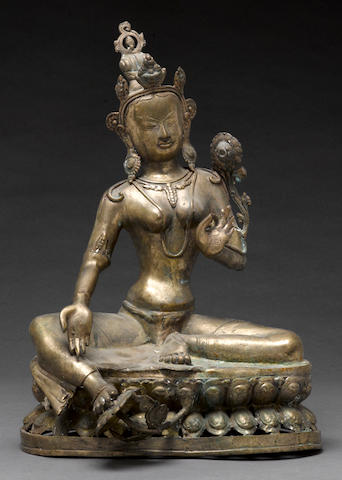 A cast metal figure of green Tara