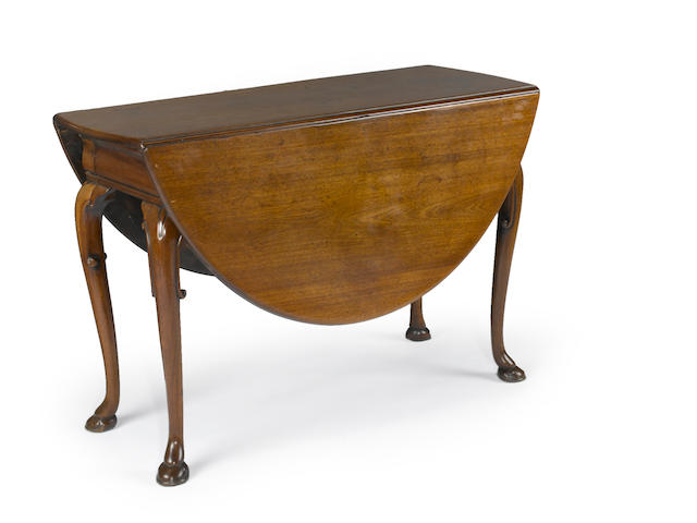 A George II mahogany  dining table <BR /> mid 18th century