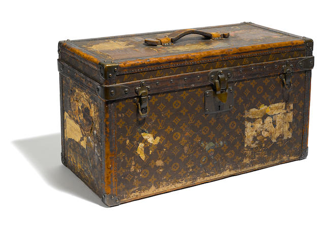 A Louis Vuitton hard sided travel case