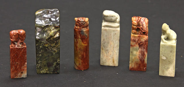 A group of six soapstone seals