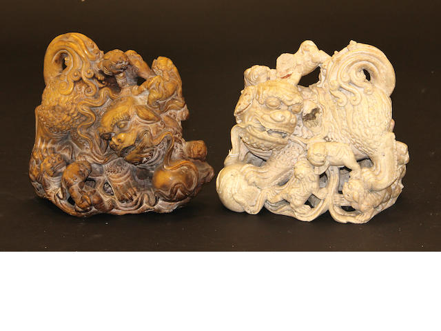 Two soapstone carvings of lions