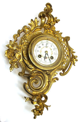 A Louis XV style gilt bronze cartouche form wall clock early 20th century