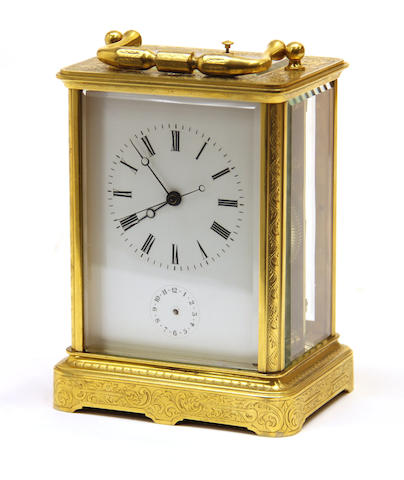 A Swiss engraved gilt brass cased carriage clock with repeat and alarm third quarter 19th century
