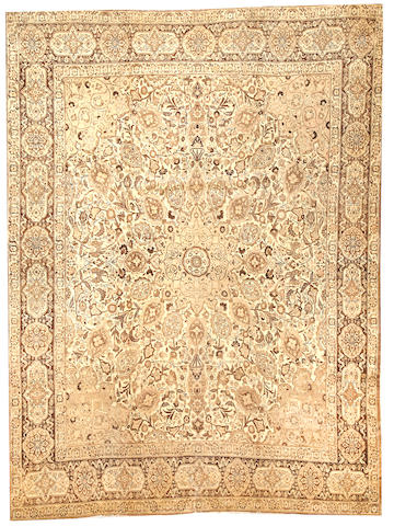 A Tabriz carpet Northwest Persia size approximtely 8ft. 6in. x 11ft. 2in.