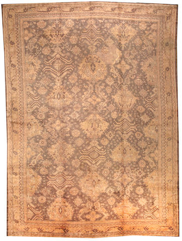 An Oushak carpet  West Anatolia size approximately 12ft. x 16ft. 3in.