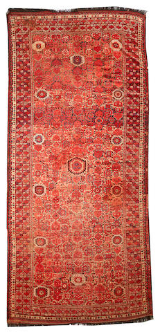 A Beshir long carpet Afghanistan size approximately 7ft. 3in. x 16ft. 2in.