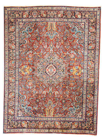 A Sarouk carpet Central Persia approximately   10ft. x 12ft.