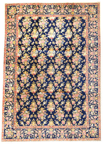 A Kerman carpet South Central Persia size approximately 9ft. 3in. x 13ft.