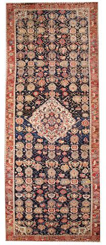 A Northwest Persian long carpet Northwest Persia size approximately 7ft. 1in. x 16ft. 8in.