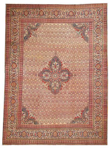 A Hadji Jalili Tabriz carpet  Northwest Persia size approximately 9ft. 4in. x 12ft. 8in.