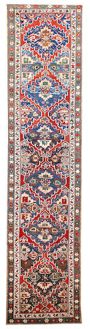 A N.W. Persian runner Northwest Persia size approximately 3ft. 7in. x 14ft. 10in.