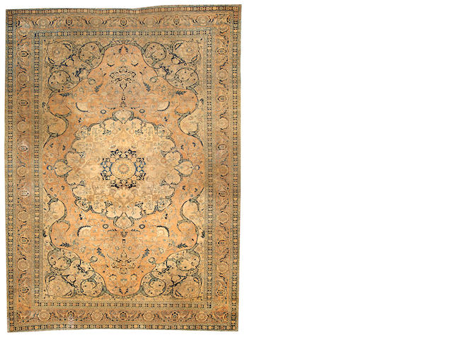 A Tabriz carpet  Northwest Persia size approximately 9ft. 2in. x 12ft. 4in.