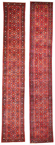 A Pair of Hamadan runners Central Persia size approximately 2ft. 8in. x 16ft. 11in and 2ft. 8in. x 16ft. 7in.