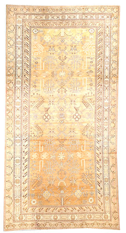 A Khotan carpet  Turkestan size approximately 6ft. 7in. x 13ft.