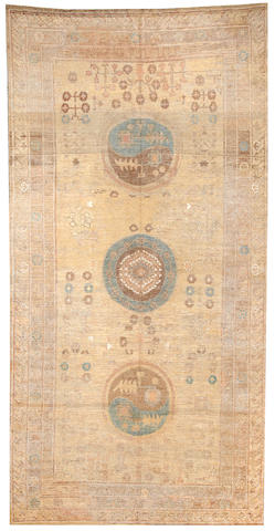 A Khotan long carpet Turkestan size approximately 6ft. 8in. x 13ft. 3in.