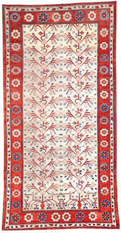 A Khotan long carpet  Northwest Persia size approximately 6ft. 3in. x 12ft. 5in.