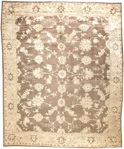 An Oushak carpet West Anatolia size approximately 11ft. 9in. x 14ft. 2in.