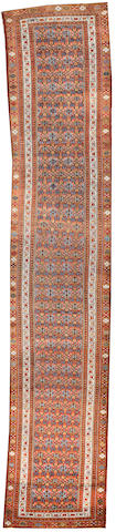 A Malayer runner  Central Persia size approximately 3ft. 5in. x 17ft. 1in.