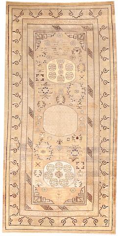 A Khotan long carpet  Turkestan size approximately 6ft. 3in. x 12ft. 4in.