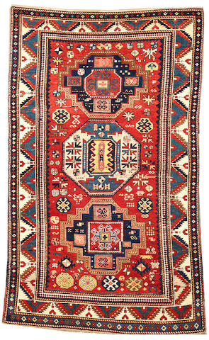 A Kazak rug  Caucasus size approximately 4ft. 7in. x 7ft. 8in.