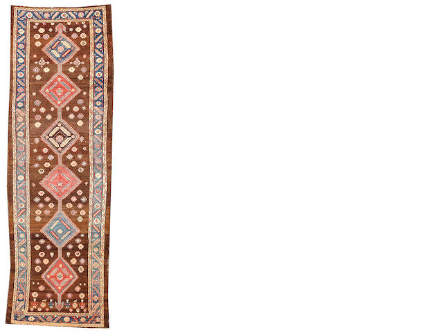 A Serab runner  Northwest Persia size approximately 3ft. 6in. x 10ft. 10in.