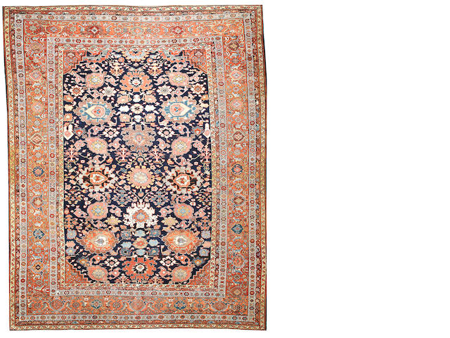 A Sultanabad carpet  Central Persia size approximately 11ft. 2in. x 14ft. 1in.