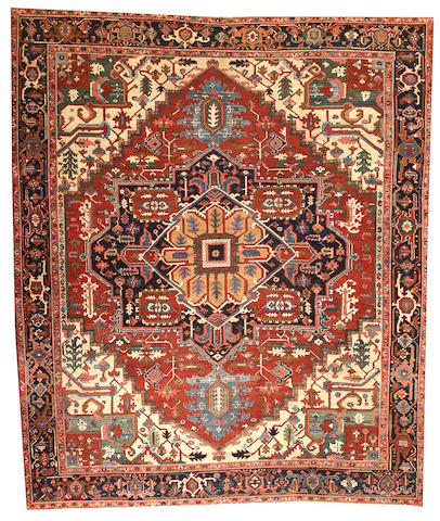 A Serapi carpet  Northwest Persia size approximately 9ft. 7in. x 11ft.